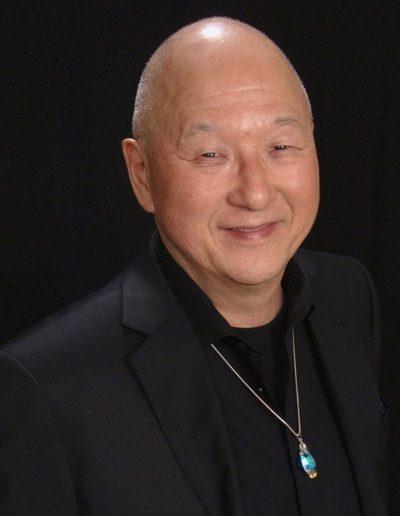 Kenji black suit photo